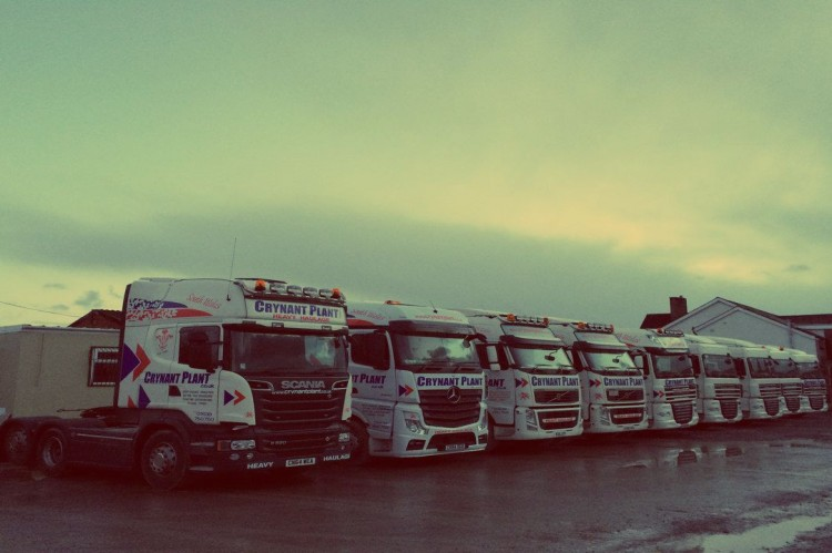 The truck fleet of Crynant Plant & Construction ltd., including Scania and Mercedes trucks in Neath.